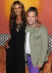 "Model Iman and designer Carlos Mota attends the launch of the ""IMAN Home"" Spring 2011 collection"