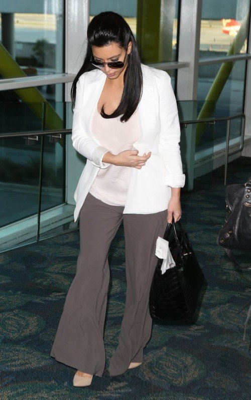 "Kim-Kardashian Casual  Outfit at Miami Airport : ""I love to be comfy when I travel and I love this look! Loose, baggy… just super comfy! Style Snapshot: I'm wearing Rick Owens pants, Monika Chang tank, Philip Lim blazer, Jimmy Choo heels."""