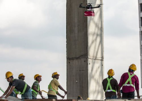 Guest workers looking on as the Coke Drones bring Happiness from the Skies