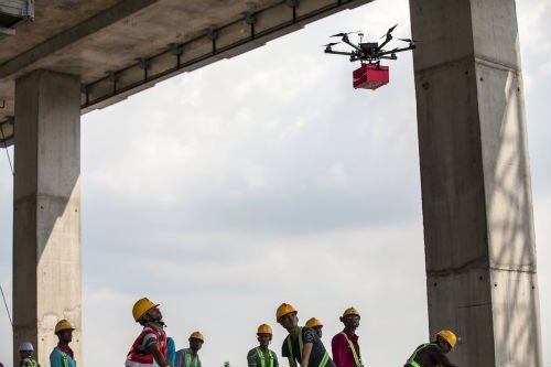 Guest workers watching as the Coke Drones fly in