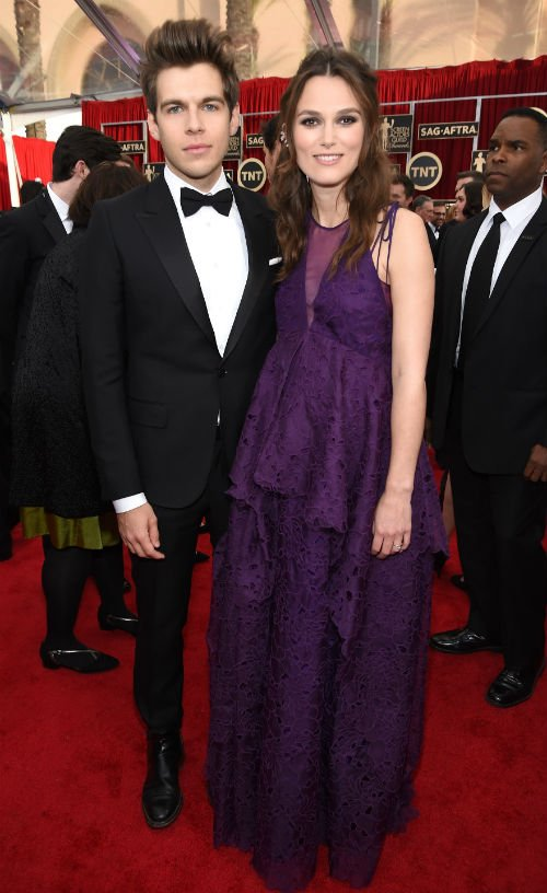 Pregnant Keira Knightley (in a a purple Erdem dress) and her husband Klaxons' James Righton