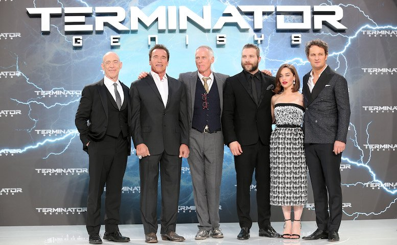 (L-R) Actors J.K. Simmons, Arnold Schwarzenegger, director Alan Taylor, actors Jai Courtney, Emilia Clarke and Jason Clarke attend the European Premiere of 'Terminator Genisys' at the CineStar Sony Center on June 21, 2015 in Berlin